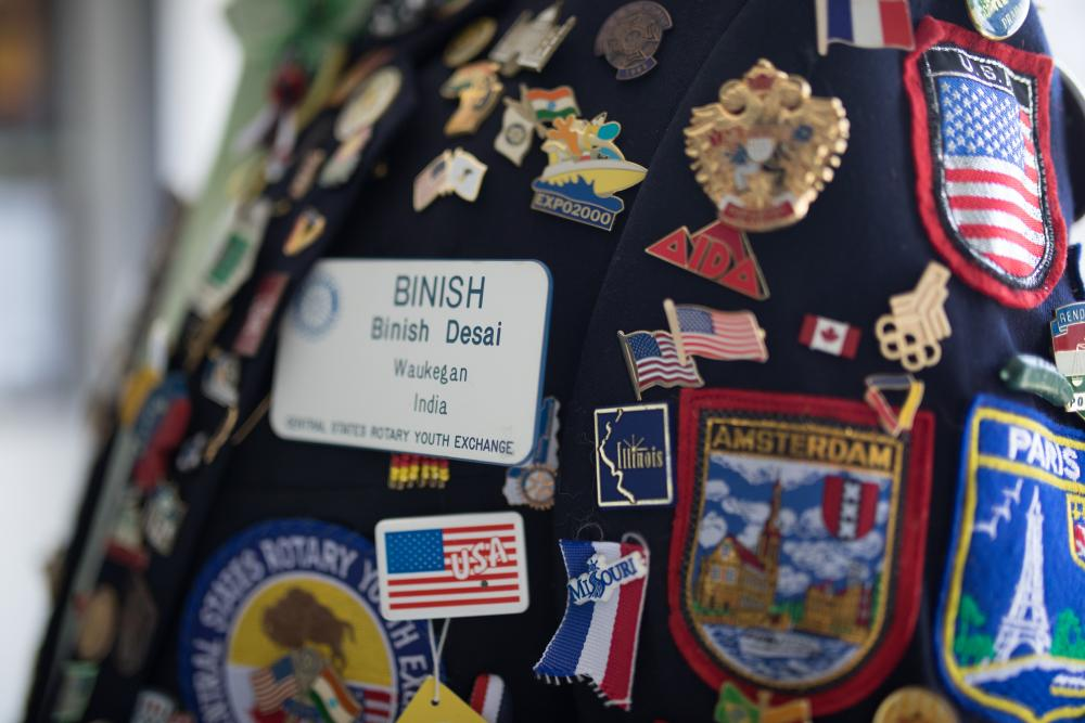Desai's collection of badges on blazer
